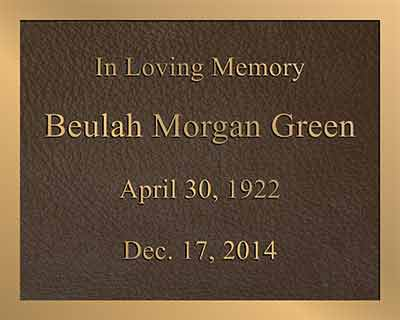 bronze memorial plaque with color photo